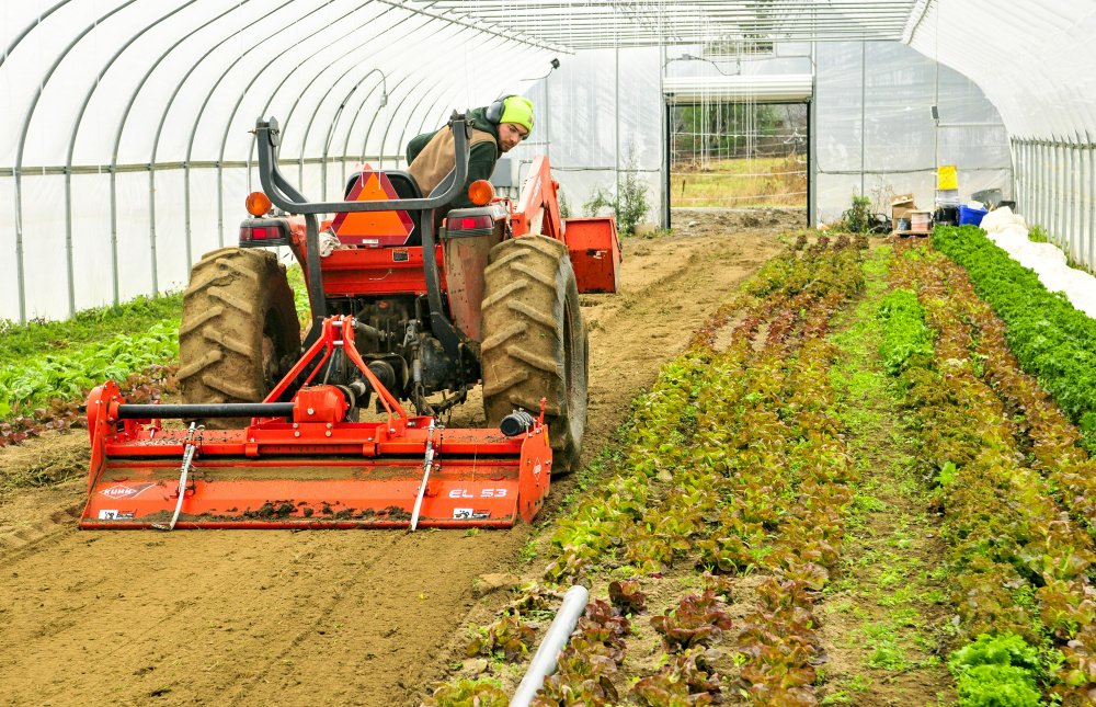 Kevin Leavitt looks back at a rototiller Thursday while preparing soil for planting in a greenhouse at Farmer Kev's Organic in West Gardiner. Beans and tomatoes had been in that space, and he'll plant lettuce, spinach and other greens there soon.
