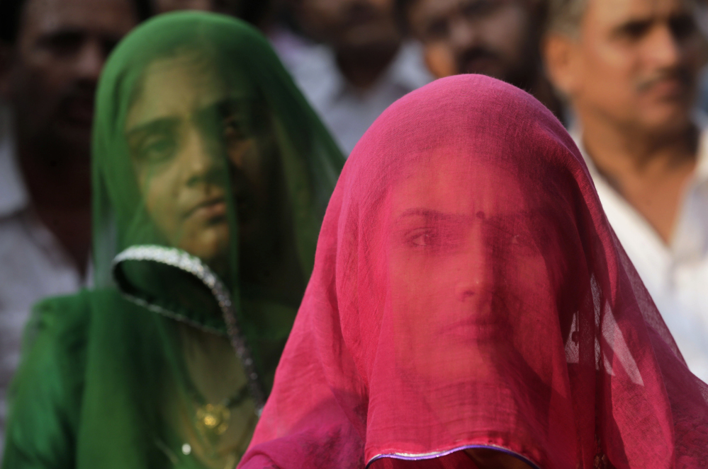 Members of India's Rajput community listen to a speech Monday at a Mumbai protest against the film