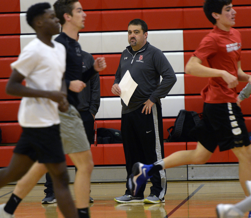 South Portland Coach Kevin Millington watches his boys' basketball players run Monday on the first day of practice for Maine's winter sports teams. South Portland was the Class AA runner-up the last two seasons.