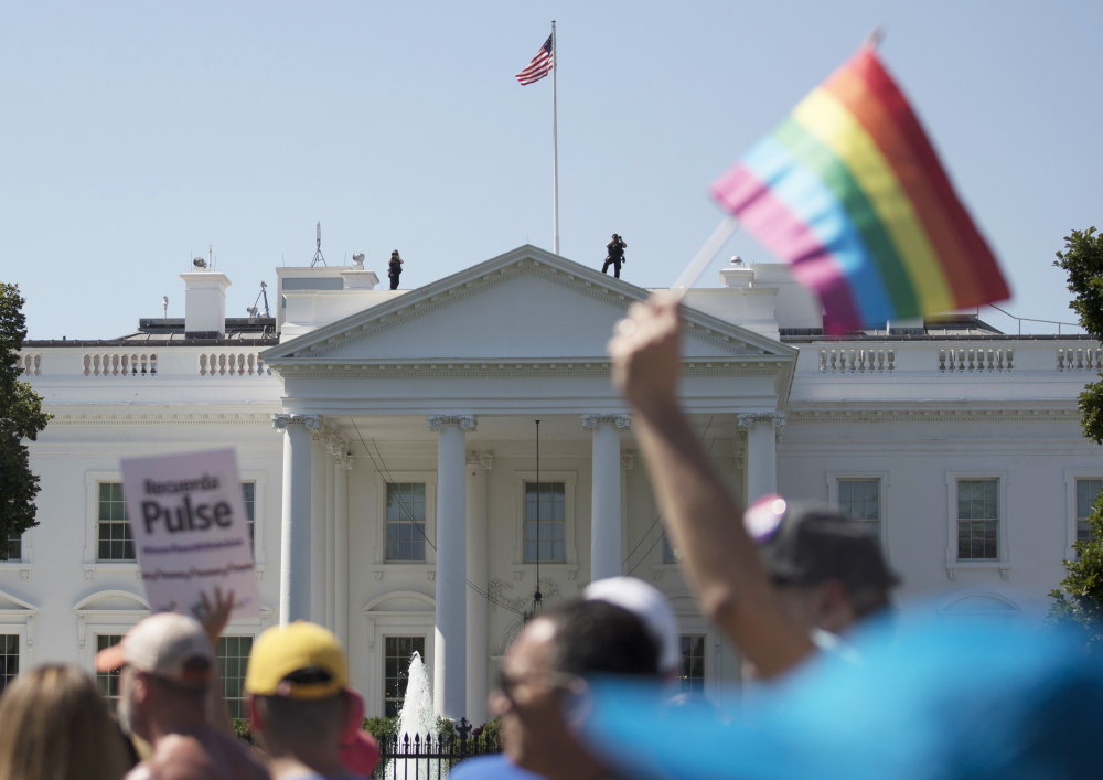 Equality March for Unity and Pride participants march past the White House in Washington in June. A second federal judge has halted the Trump administration's proposed transgender military ban.