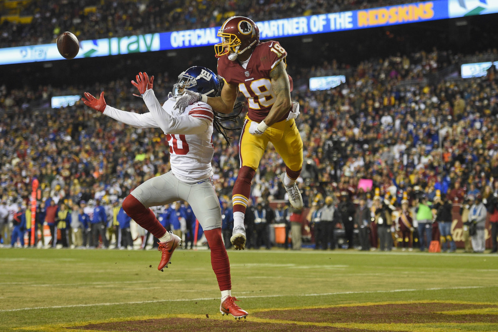 New York Giants cornerback Janoris Jenkins reaches for a pass intended for Washington wide receiver Josh Doctson during the first half in Landover, Md., on Thursday.