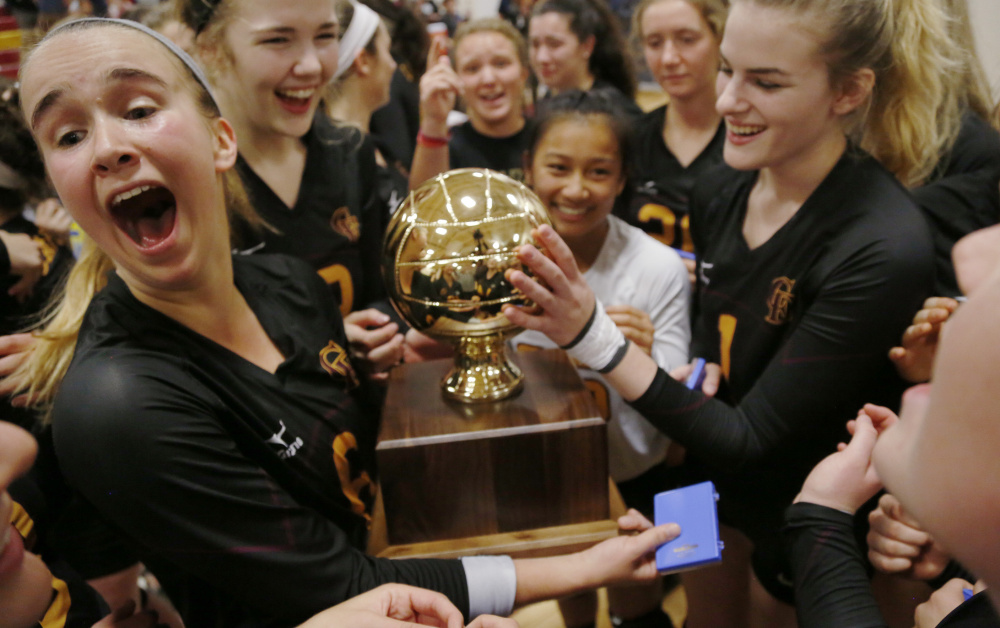 Megan Connelly, left, said more time was spent this season in the weight room and working on conditioning. It paid off when Cape Elizabeth captured a state volleyball championship.