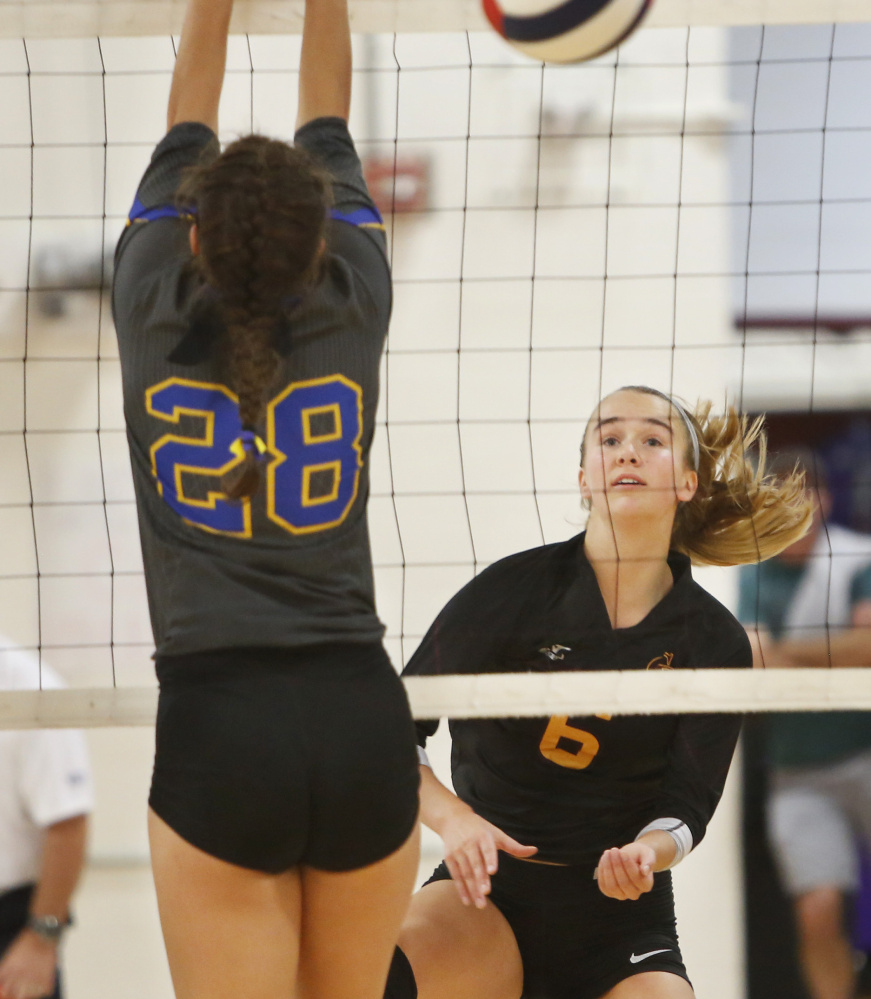 Megan Connelly of Cape Elizabeth, watching her volley go over the net during the state final against Falmouth, came up big time after time for the Capers, who capped a perfect season with a state championship.