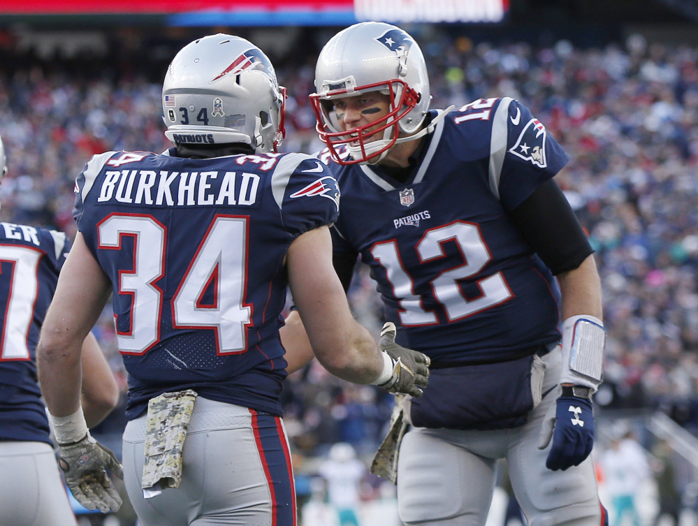 Tom Brady celebrates a touchdown pass to running back Rex Burkhead in the first half of the Patriots' 35-17 win over the Miami Dolphins on Sunday in Foxborough. New England is on track for yet another AFC East title.