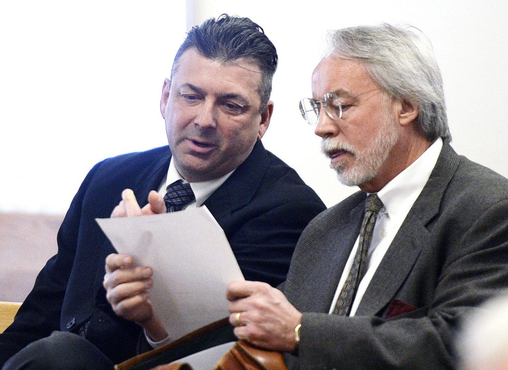 Thomas Fortier, left, seen in court with his attorney Bruce Merrill in March, testified Tuesday that it's