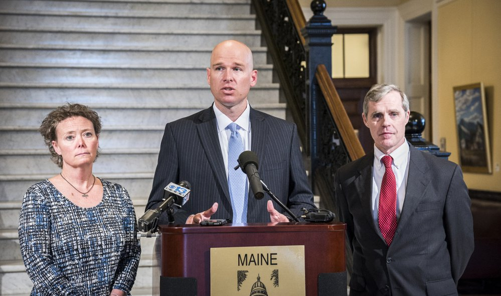 Toni Richardson, left, filed charges of religious discrimination and retaliation with the Equal Employment Opportunity Commission against the Augusta School Department, for which she works as an educational technician. She is joined by her attorneys Jeremy Dys, center, and Timothy Woodcock. Richardson claims the Augusta schools punished her for using religious phrases while in private conversations with a coworker.