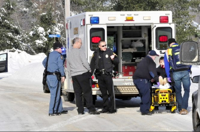 Edward Domasinsky is loaded into an ambulance with injuries to his face that police say were self inflicted following a domestic dispute with a woman at a residence on Horseback Road in Clinton on Jan. 5, 2014.