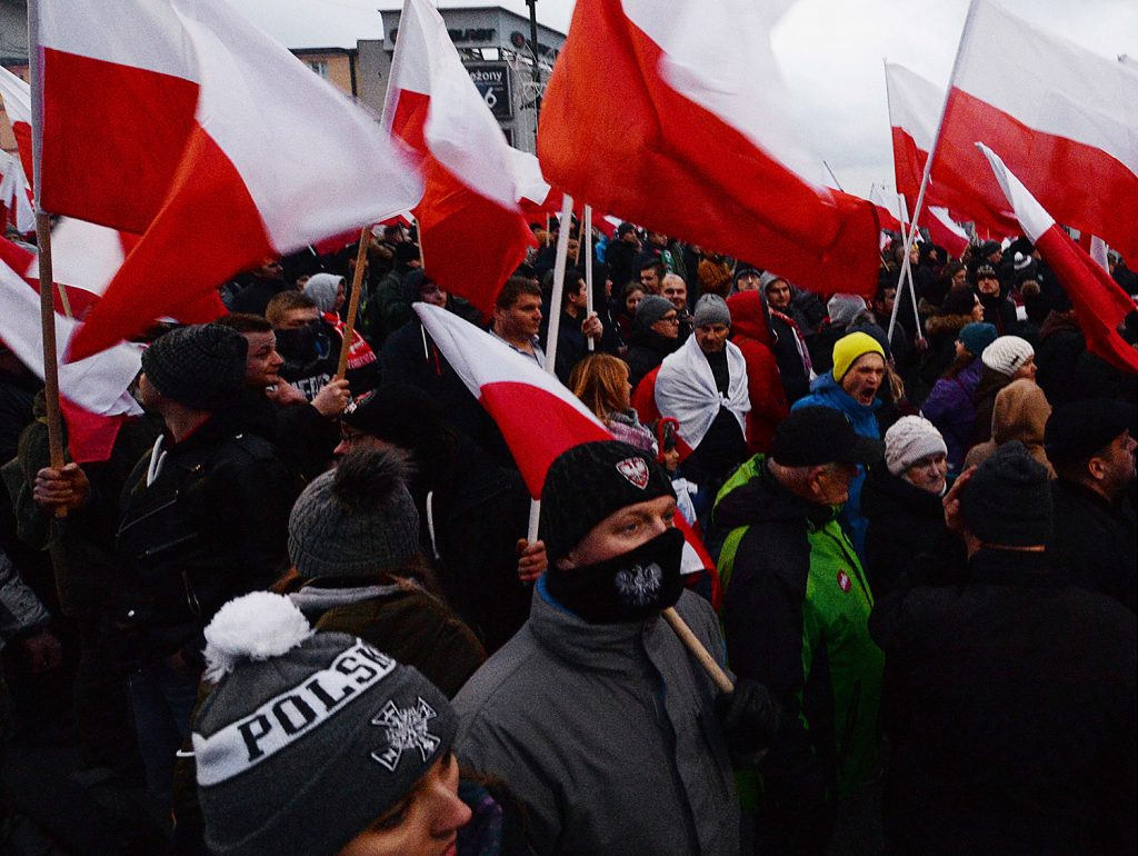 Demonstrators wave Polish flags Saturday in Warsaw during the annual march to commemorate Poland's National Independence Day. Thousands of nationalists marched in an event organized by far-right groups.
