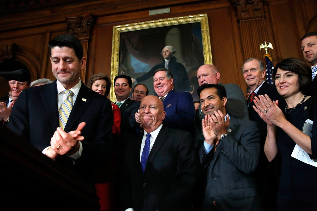 House Speaker Paul Ryan of Wisconsin, left, leads applause for House Ways and Means Chair Rep. Kevin Brady, R-Texas, along with Rep. Carlos Curbelo, R-Fla., and Rep. Cathy McMorris Rodgers, R-Wash., during a news conference following a vote on tax reform on Capitol Hill in Washington on Thursday. Republicans passed a nearly $1.5 trillion package overhauling corporate and personal taxes through the House.
