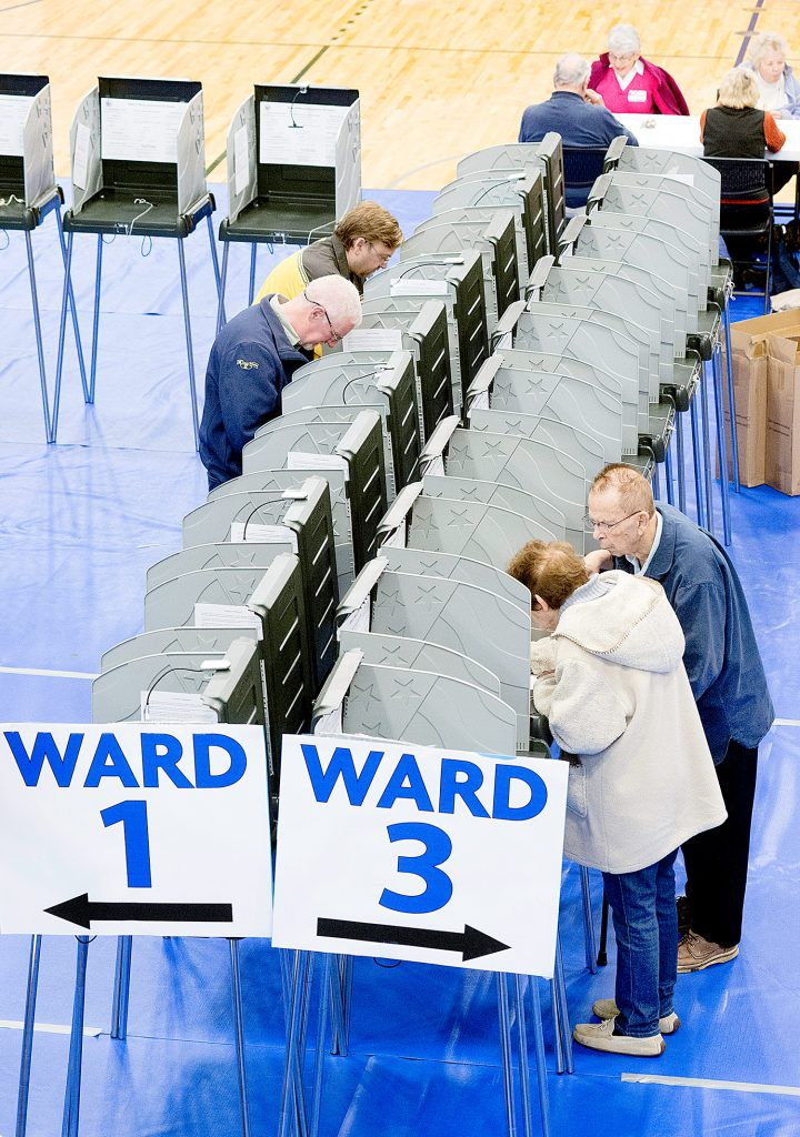 Lewiston residents cast their votes at the Lewiston Memorial Armory on Tuesday. On their local ballot was a proposal for Lewiston and Auburn to merge.