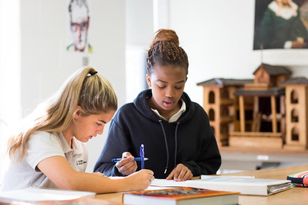 Enrollment at Maine Girls' Academy in Portland will expand when the school starts admitting seventh- and eighth-grade students next fall. Studying here are sophomores Victoria Silva, left, and Estella Mutoni.