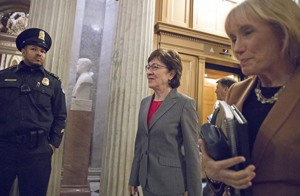 Sen. Susan Collins, R-Maine, with Sen. Maggie Hassan, D-N.H., right, head to the Senate floor for votes on Capitol Hill on Monday evening. The tax reform bill that Collins could support would balloon the deficit and provide hefty tax cuts for the wealthy, while raising taxes on about 50 percent of Americans in 2027, said the Tax Policy Center, a Washington-based think tank.