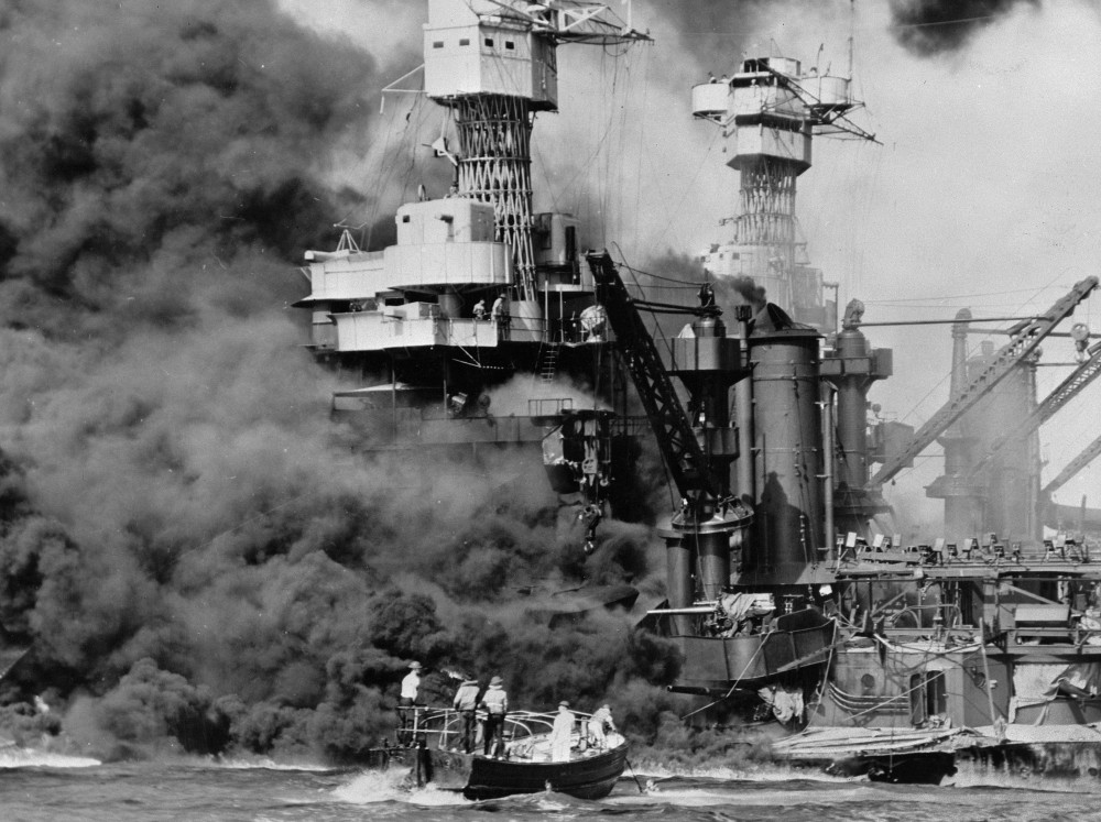 A small boat rescues seamen from the USS West Virginia in Pearl Harbor, Hawaii, on Dec. 7, 1941. About 2,400 U.S. service members and civilians were killed in the attack.