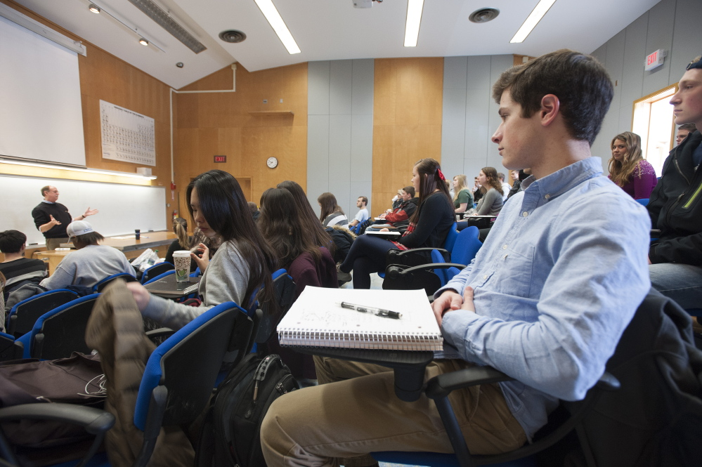 Students listen to a University of Maine macroeconomics lecture in 2015. Readers say a column pushing changes to the college system missed a couple points.