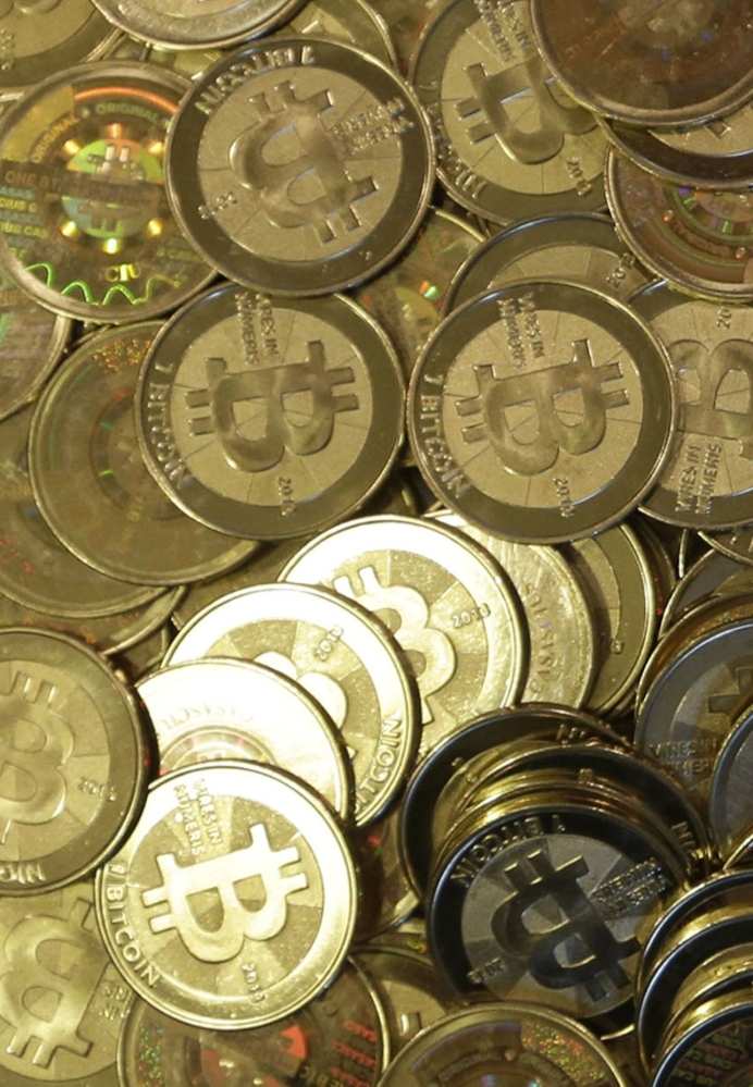 With a federal OK, the CME Group, which owns the Chicago Mercantile Exchange, will start trading bitcoin futures Dec. 18.