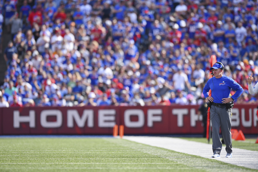 Tyrod Taylor carted to locker room with knee injury