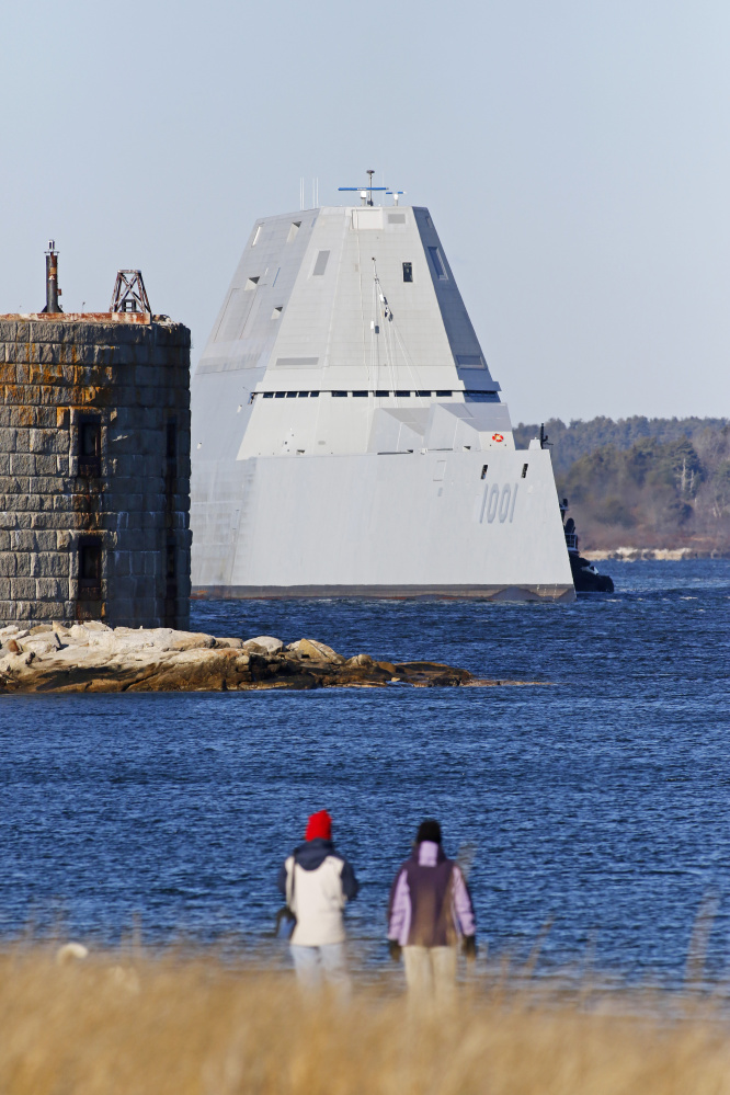 People watch as the newest Zumwalt-class stealth destroyer built by BIW passes Fort Popham as it takes a test run Monday down the Kennebec River.