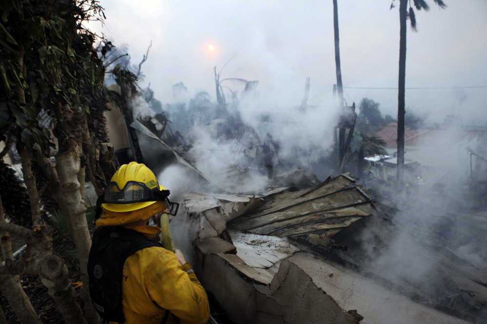 A raging fire is encroaching on celebrity homes in Los Angeles