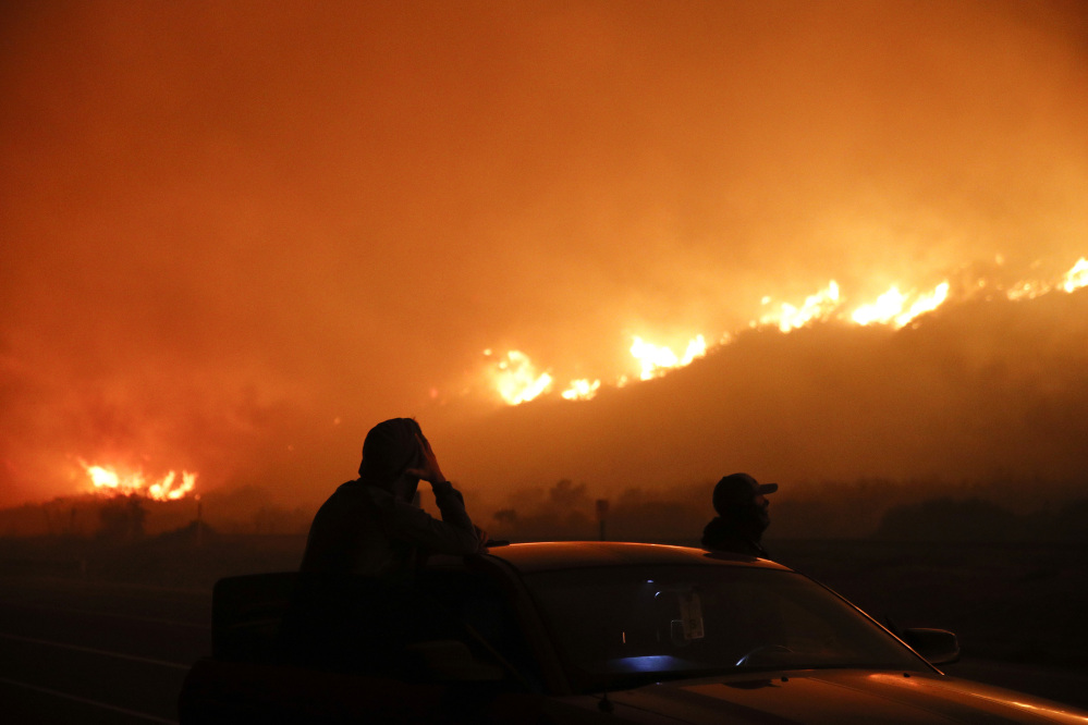 Commuters share terrifying videos of raging wildfire along LA freeway