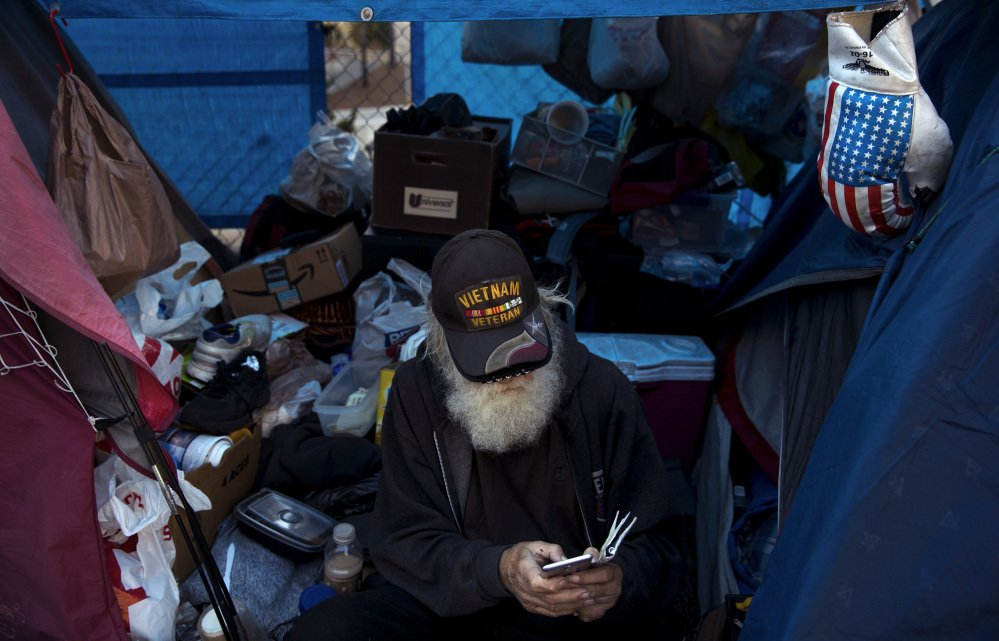 A federal initiative has nearly halved veteran homelessness, but 78-year-old Vietnam veteran Theodore Neubauer, who lives in a tent in Los Angeles, is among the 40,000 nationwide who still need housing.