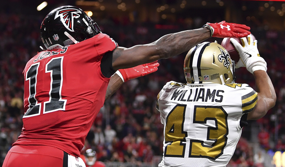 Saints free safety Marcus Williams picks off the ball against Atlanta Falcons wide receiver Julio Jones in the second half Thursday night in Atlanta.