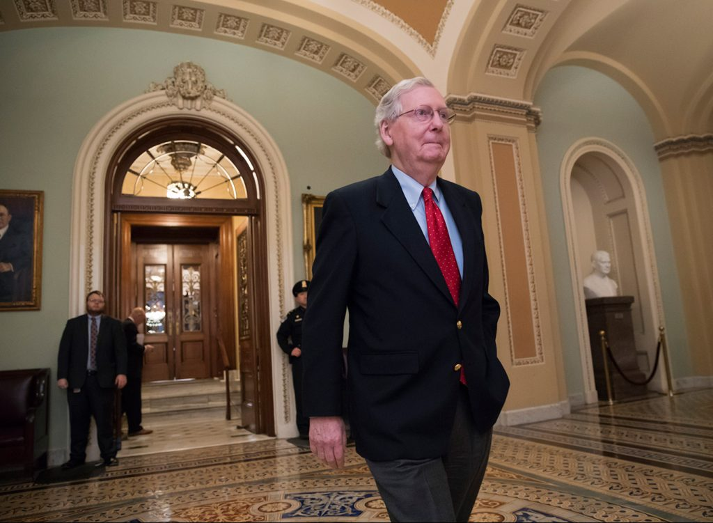 Senate Majority Leader Mitch McConnell, R-Ky., walks from the Senate chamber to his office late Friday night during votes on amendments to the Republican tax overhaul.