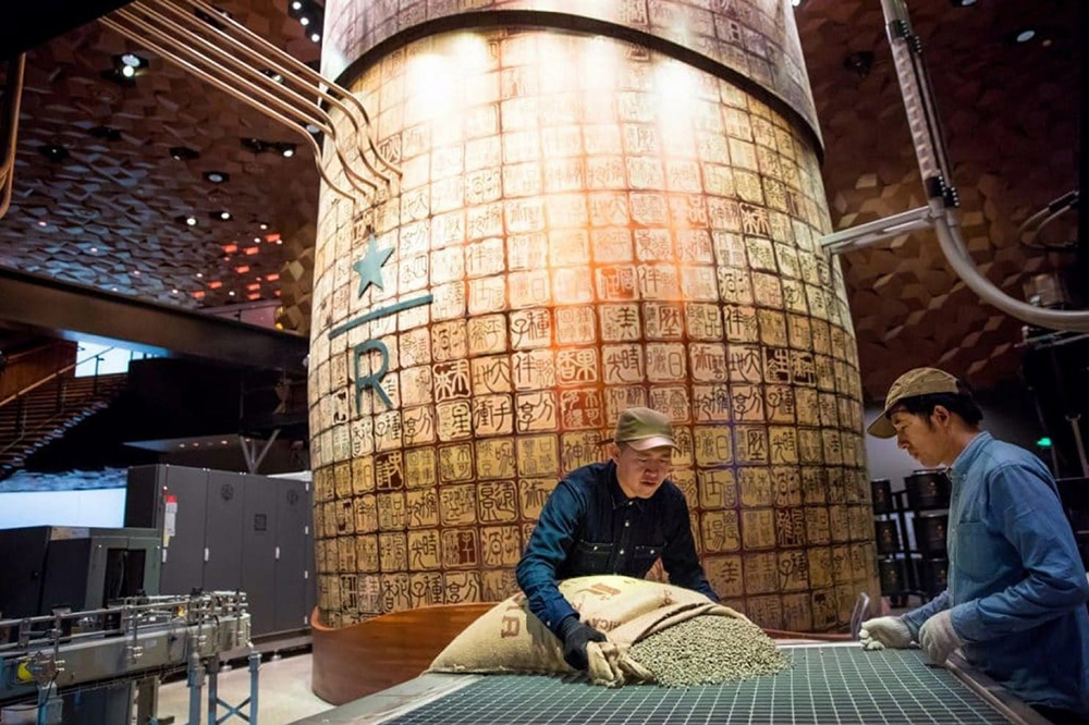 Green coffee is loaded in the new Starbucks Roastery in Shanghai last Friday.