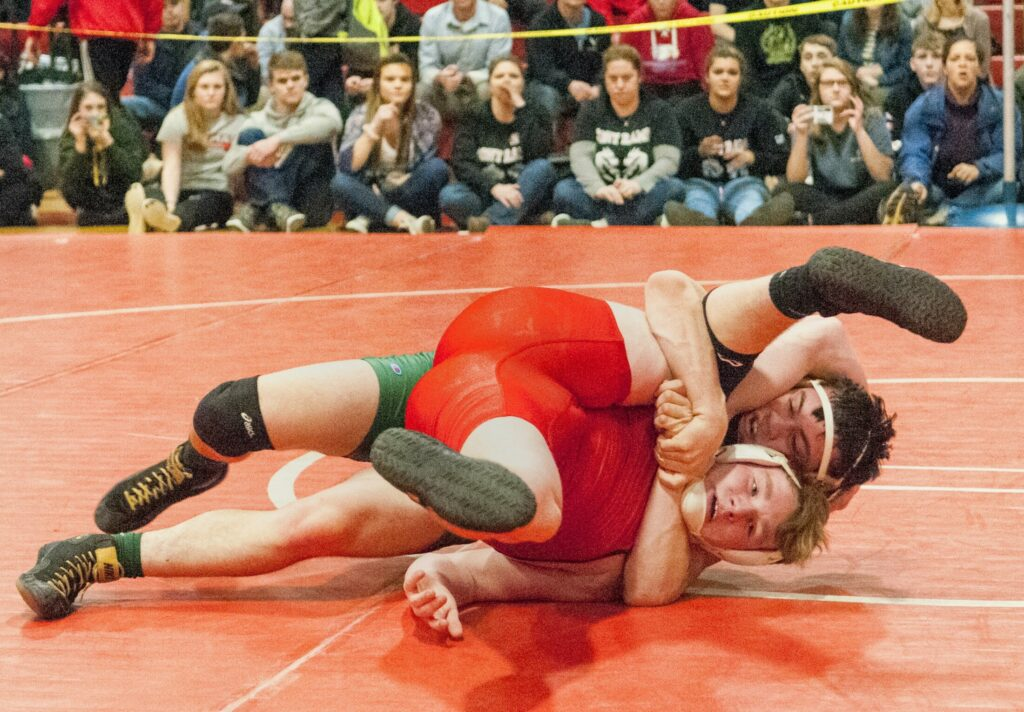 Cony's Aaron Lettre, bottom, wrestles with Oxford Hills' Cole Dunham during the 182-pound championship bout at the Class A state meet last season at Cony High School.