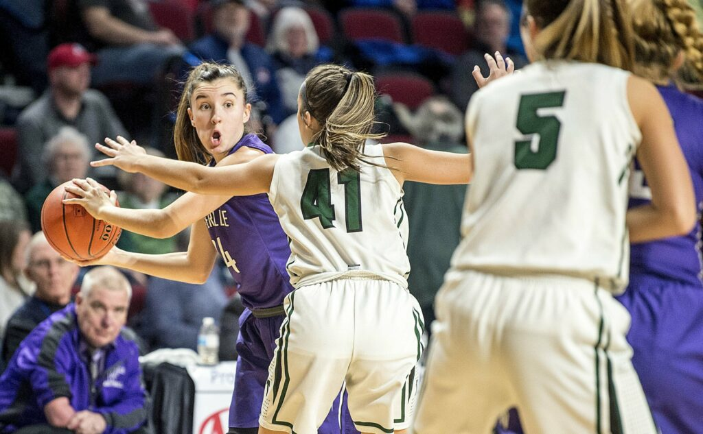 Waterville's Sadie Garling (24) looks to pass the ball as Mt. Desert Island defender Hannah Chamberlain closes in during the second half of the Class B North championship game last season at the Cross Insurance Center in Bangor.