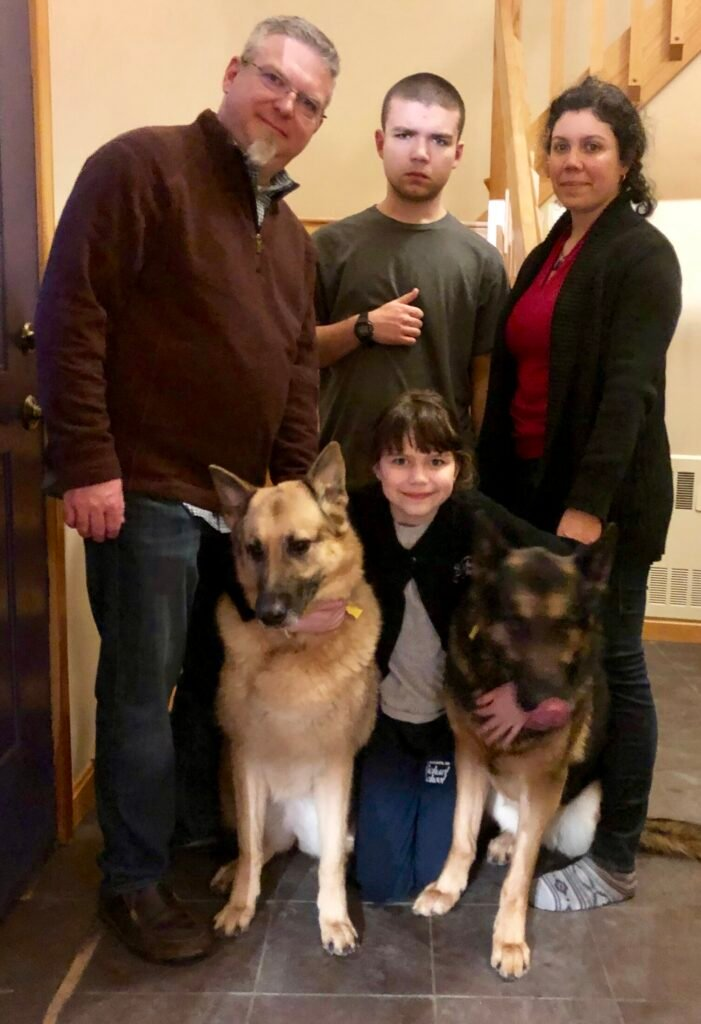 The Reight family poses with their two German Shepherds, Anani and Luna. Anani fell through ice on Belgrade Stream and was rescued by Readfield Fire Department, which had just received ice water rescue suits that day. Standing are, from left, Dr. Ian Reight, Julian Reight and Jeanett Reight; and, kneeling, Amalia Reight.