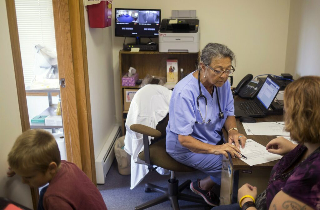 Nurse practitioner   Priscilla Perry meets with a patient in her office at the Machias branch of Maine Family Planning in 2017. The organization is seeking state funds to replace $2 million in federal funding that Maine Family Planning declined because it would have restricted the information it could give to patients.