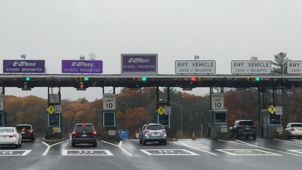 Cars pass through the York tolls on the Maine Turnpike in this file photo from March 2019. The Maine Turnpike Authority plans to increase tolls at its York Toll Plaza from $3 to $4 for cash payers.