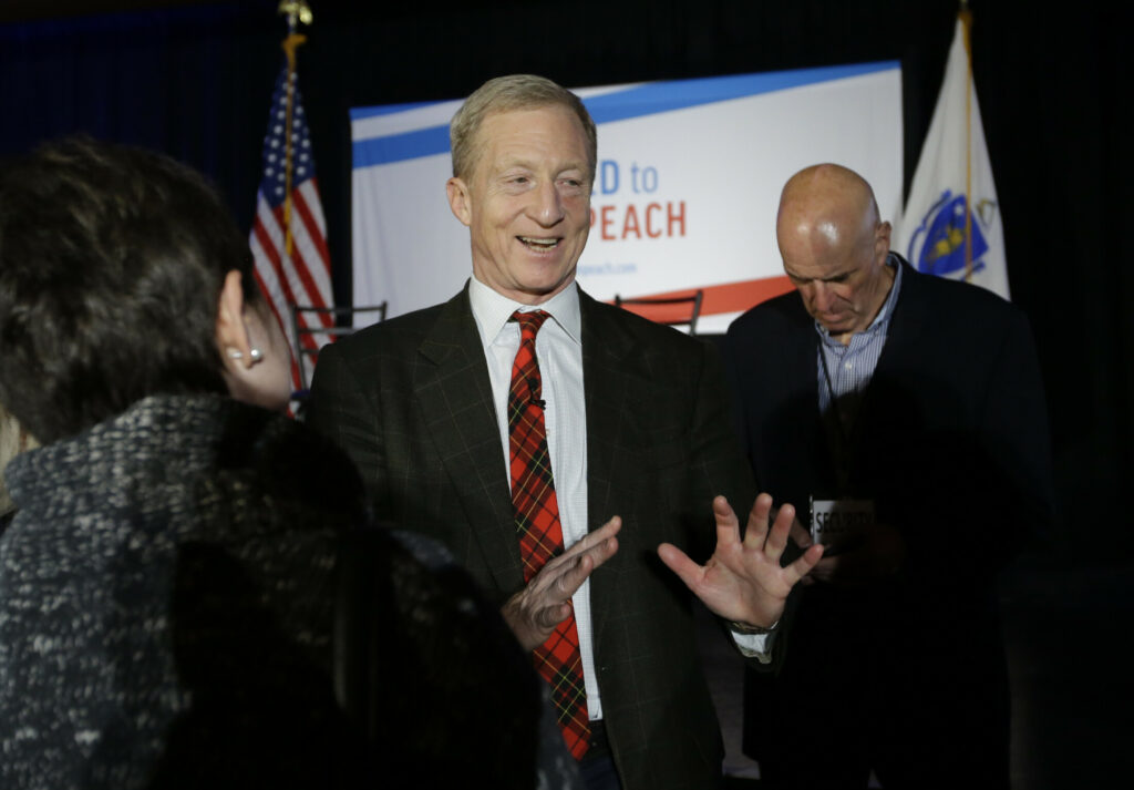 """Billionaire investor and Democratic activist Tom Steyer, center, greets people in the audience at the conclusion of a """"Need to Impeach"""" town hall event on March 13 in Agawam, Mass. Steyer claims that President Trump meets the criteria for impeachment."""