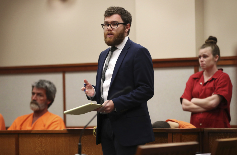 Attorney Taylor Sampson addresses the judge while defending indigent citizens at Cumberland County Superior Court in Portland in this 2017 Associated Press photo. Maine is the only state in the nation without a public defender's office.