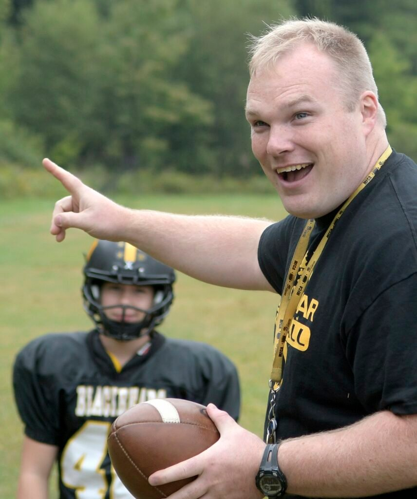 Maranacook football coach Walter Polky enjoys a light moment during a 2017 practice in Readfield. Polky was named the next football coach at Messalonskee High School.
