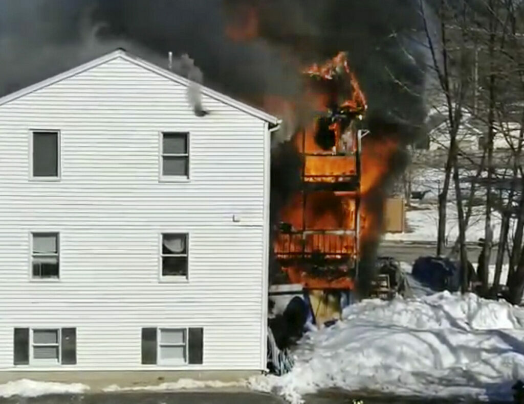 Flames tear through the apartment building at 10 Bell St. in Berwick on March 1 in this image from a neighbor's video. Fire officials said Friday that the fire was started by discarded smoking materials.