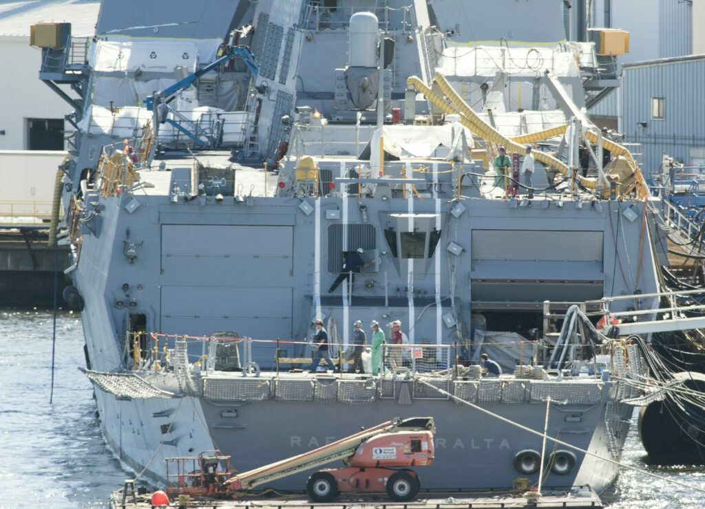 BATH, ME - SEPTEMBER 16: Workers walk across the aft deck of an Arleigh Burke destroyer on Friday, September 16, 2016 that is currently under construction at Bath Iron Works in Bath. (Photo by Gregory Rec/Staff Photographer)