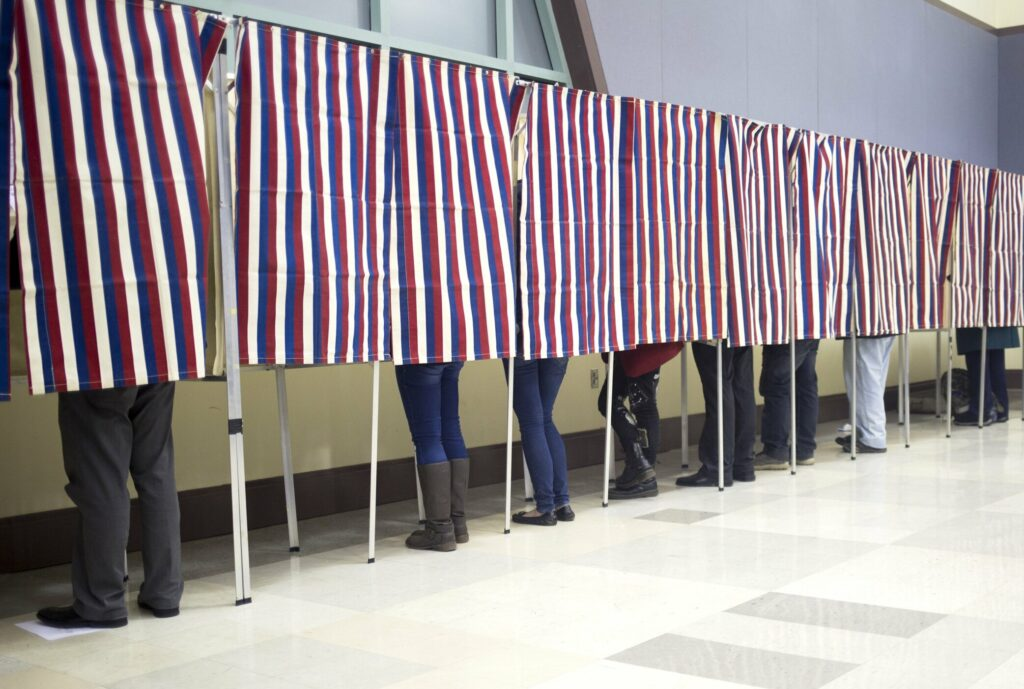 Voters fill out their ballots in the voting booths at Merrill Auditorium in 2016.