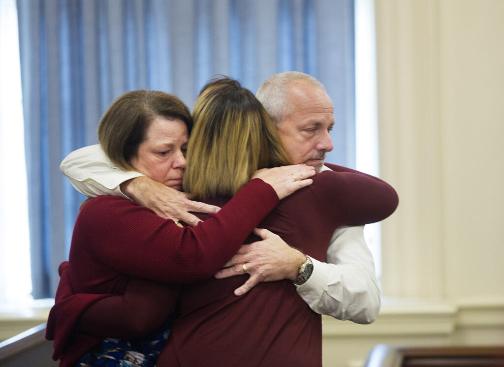 Chris and Sandy Ward of Standish hug a woman they described as Joshua Dall-Leighton's girlfriend after the jury delivered its verdict clearing their nephew of all charges on Thursday.
