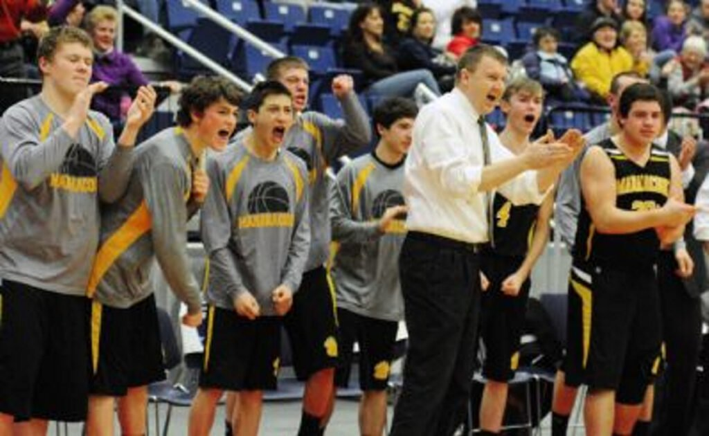 Maranacook coach Rob Schmidt cheers as the clock runs down during a Western C semifinal game against Winthrop in 2015. Schmidt stepped down as coach.