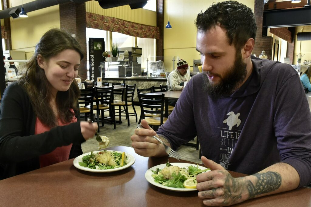 University of Maine at Farmington employee Jane Metsker and friend Richard Dubs said they enjoyed the Maine-caught hake served in the South Dining Hall on Tuesday. The college is making an effort to support Maine producers of food.