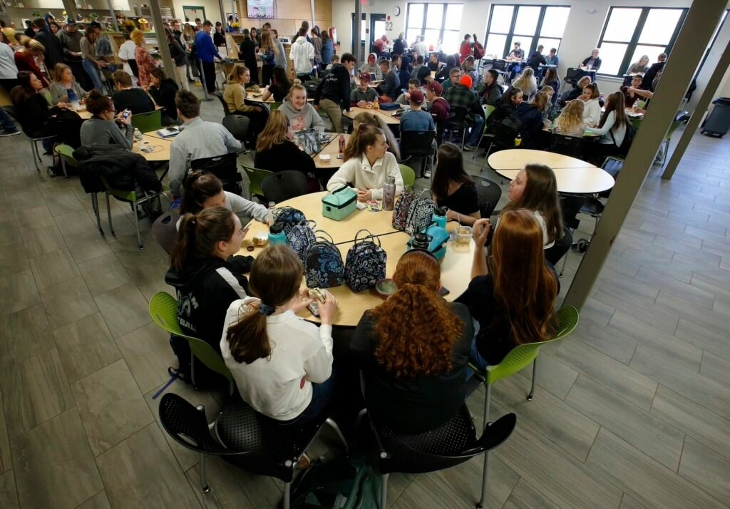 Students fill the cafeteria at Gorham High School in April 2019.