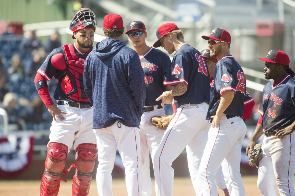 Pitching coach Paul Abbott and the Portland Sea Dogs' infielder joins pitcher Tanner Houck, 20, on the mound during a three-run fourth inning Saturday that helped the Reading Fightin Phils to an 8-1 victory at Hadlock Field.