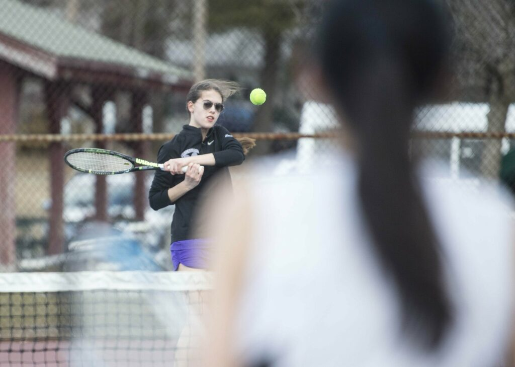 Waterville's Inga Zimba, facing, returns a shot from Kents Hills singles player Rina Akasaka during a preseason match at the North Street courts in Waterville.