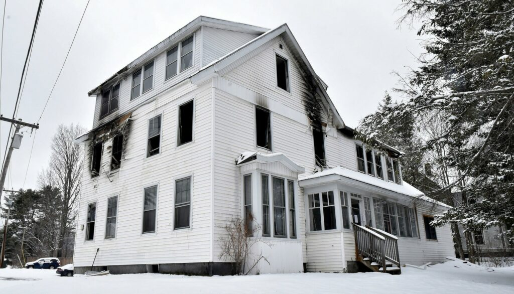The burned apartment building at 378 Water St. in Skowhegan is on Tuesday. Authorities said a fire at the building last week was sparked after siding blew off, hit utility wires and triggered electricity surges inside.
