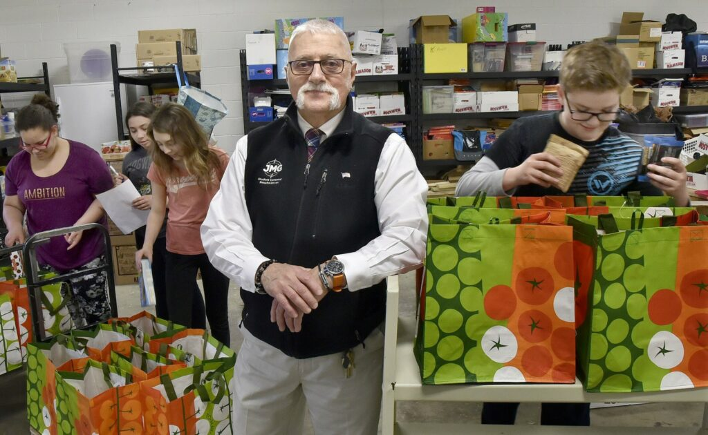 Victor Esposito, a Jobs for Maine Graduates specialist, works with JMG students Friday at Vassalboro Community School in an in-school food pantry project. He has been named 2018 Mid-Maine Chamber of Commerce's Outstanding Professional.