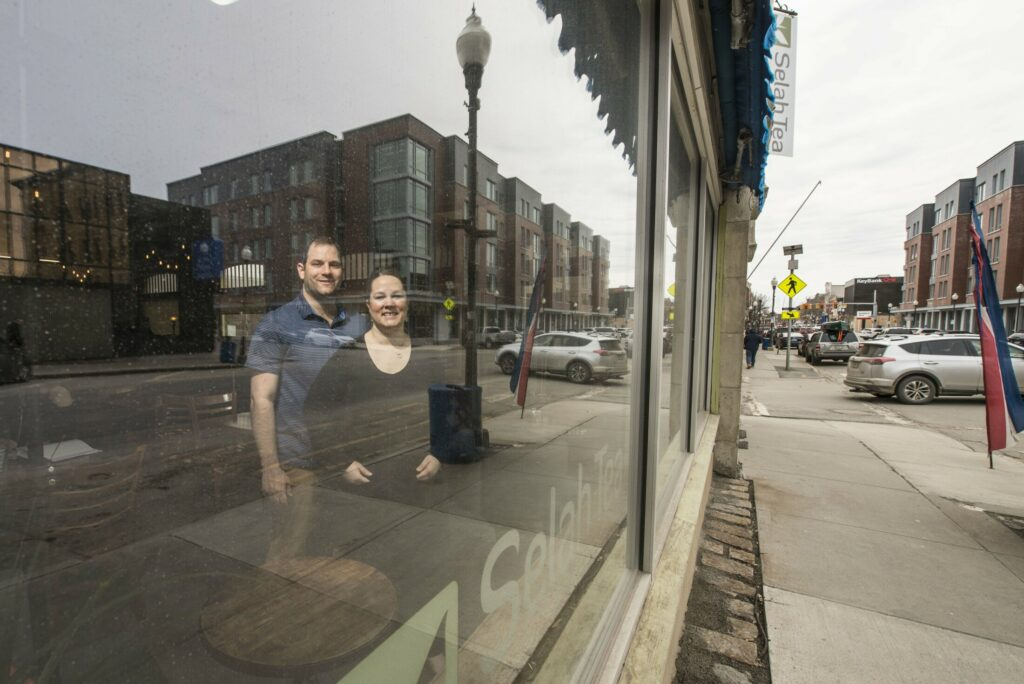 Bobby and Rachel McGee, owners of Selah Tea on Main Street in Waterville, pose Friday in their restaurant. Selah Tea is a beneficiary of Waterville's Façade and Building Improvement Grant Program.