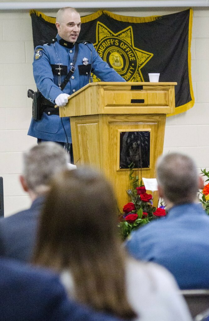 Maine State Police Trooper G.J. Neagle gives a eulogy during Donald Williams' funeral Saturday at the Maine Criminal Justice Academy in Vassalboro.