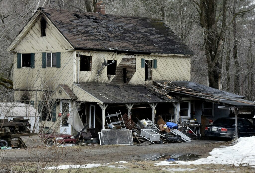 The burned remains of the home on Moore Street in Anson a day after owner Richard Duley died there Sunday.