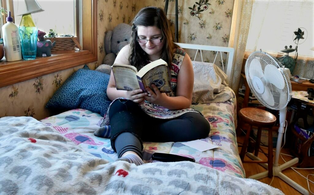 Cierrah French, 12, sitting on her bed on Wednesday in her grandparents Alicia and Wayne Blodgett's home in Skowhegan on Wednesday, is a voracious reader. Cierrah will undergo surgery in Boston on Tuesday for cancer in her leg.